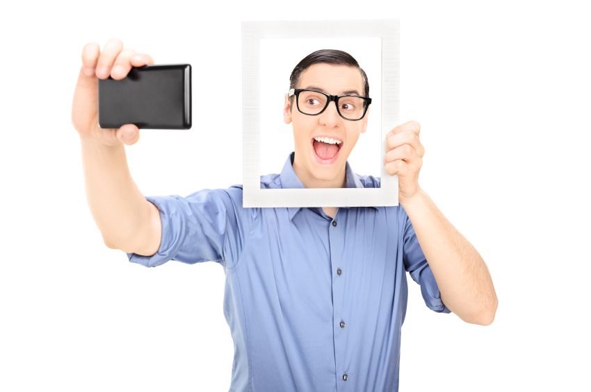 Man taking a selfie and holding a picture frame